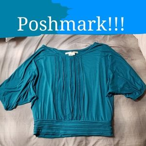 Very flattering turquoise blouse